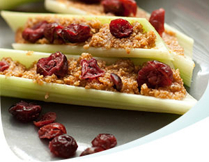 Celery topped with peanut butter and raisins